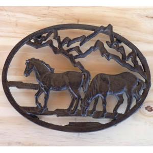 Dessous de plat en fonte avec 2 chevaux